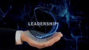 Malująca ręka pokazuje pojęcie holograma przywódctwo na jego ręce Obraz Royalty Free