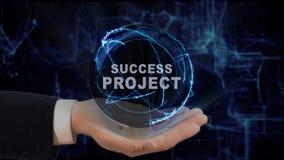 Malująca ręka pokazuje pojęcie holograma sukcesu projekt na jego ręce Zdjęcia Stock