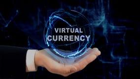 Malująca ręka pokazuje pojęcie hologramowi Wirtualną walutę na jego ręce Obrazy Stock