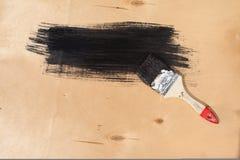 Malujący czarny pudełko na pokładzie Obrazy Royalty Free