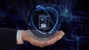 Maluj?ca r?ka pokazuje poj?cie hologramowi 3d bezpiecznego pieni?dze na jego r?ce fotografia stock