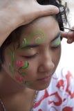 malująca twarzy dziewczyna Obrazy Stock