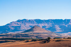 Maluti Mountains Landscape Winter. Winter landscape in the Maluti mountains. Dry fields and large mountain backdrop into the blue sky Royalty Free Stock Photography