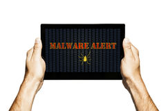 Malware alert in a tablet screen. Hands holding tablet. Isolated. Hands holding tablet with malware alert notification in the screen royalty free stock photos