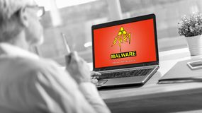 Malware concept on a laptop screen. Laptop screen displaying a malware concept royalty free stock image