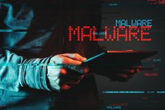 Malware concept with person using tablet computer. Low key red and blue lit image and digital glitch effect royalty free stock photography