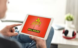Malware concept on a tablet. Tablet screen displaying a malware concept royalty free stock image