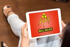 Malware concept on a tablet. Tablet screen displaying a malware concept stock image