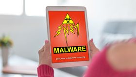 Malware concept on a tablet. Tablet screen displaying a malware concept stock photography
