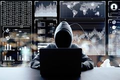 Malware and finance concept. Hacker using laptop on blurry night city background with digital business interface. Malware and finance concept. Double exposure stock photo