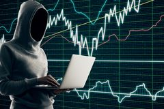 Malware and finance concept. Hacker using laptop with forex chart interface on blurry background. Malware and finance concept royalty free stock photography