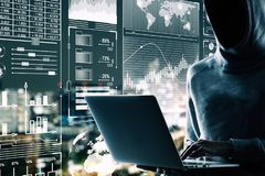 Malware and hud concept. Side view of hacker using laptop with digital business interface on blurry night city background. Double exposure royalty free stock photos