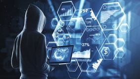 Malware and network concept. Back view of hacker with hood, laptop and digital business interface on blurry background. 3D Rendering stock photos