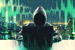 Malware and trade concept. Hacker at desktop using laptop with binary code and forex chart on blurry city background. Malware and trade concept. Double exposure royalty free stock images