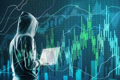 Malware and trade concept. Side view of hacker using laptop with forex chart. Malware and trade concept. Double exposure royalty free stock images