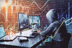 Malware and trade concept. Side view of unrecognizable hacker at desktop using computers with forex chart on blurry office background. Malware and trade concept royalty free stock image