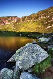 Maly Staw, mountain lake in the Poland side of Giant mountains, Krkonose. Creek from Maly Staw, mountain lake in the Poland side of Giant mountains, Krkonose royalty free stock image