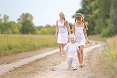 Mamá con el hijo y la hija Fotografía de archivo