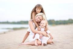 Mamá con el hijo y la hija Imagen de archivo libre de regalías