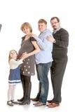 Mamá de la familia de cuatro miembros embarazada Imagen de archivo libre de regalías