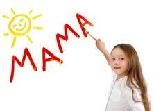 Mamá de la palabra de la escritura de la niña Imagen de archivo libre de regalías