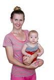 Mamã com o bebê em seus braços Fotos de Stock