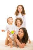 Mamã e crianças felizes na parte superior Fotografia de Stock Royalty Free