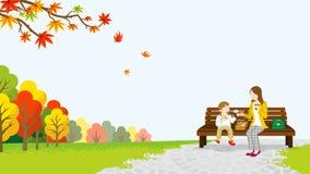 A mamã e a filha tomam parte num piquenique no parque do outono ilustração royalty free