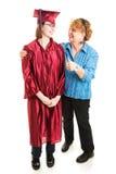 A mamã felicita a filha na graduação Imagens de Stock Royalty Free