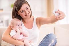 Mamã e criança Fotos de Stock