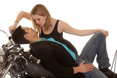 Mam lay back on motorcycle woman lean down Royalty Free Stock Photos