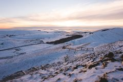 Mam tor covered in Snow during Sunset in the Peak District royalty free stock photography