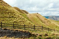 Mam Tor, Peak District. UK. Peak District National Park, Derbyshire, England. Walks in Mam Tor, view of the hills and road selective focus royalty free stock photo