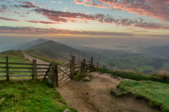 Mam Tor Sunrise, Peak District, UK. A vibrant sunrise at Mam Tor in the English Peak District with a wooden fence Royalty Free Stock Photography