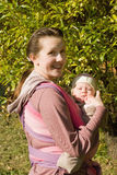 Mama with baby in sling Royalty Free Stock Image