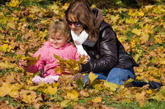 Mama with a daughter in autumn park Royalty Free Stock Photos