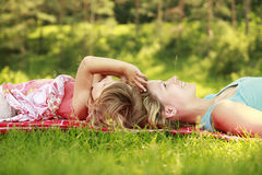 Mama and her little daughter playing on grass Royalty Free Stock Photography