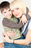 Mama hugs her son Stock Photo