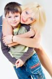 Mama hugs her son Stock Photography
