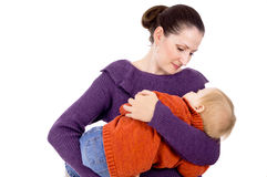 Mama lulls a child in her arms Stock Image