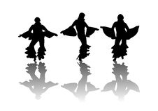 Mama Mia Dancers. Dancers moving in disco attire silhouetted on a white background with their reflection on the floor Royalty Free Stock Photos