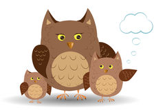 Mama owl and owlet. Owlet refers to the mother owl, owl listens Royalty Free Stock Photo