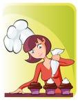 Mama que cocina la magdalena Fotografía de archivo