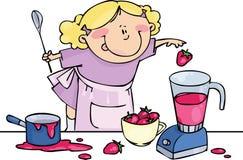 Mama's Little Helper. Little girl prepares strawberry dessert in a blender Royalty Free Stock Photography