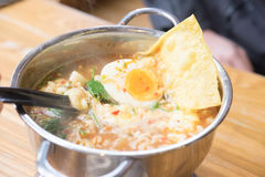 Mama soup Tom Yum Kung topped with egg Stock Images