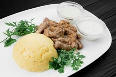 Mamaliaga or polenta with cheese and beef meat. Traditional food of Moldovan and Romanian. royalty free stock photo
