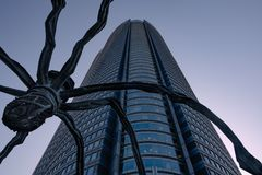 Maman big spider metal sculpture in Roppongi hills shot from below at sunset stock photos