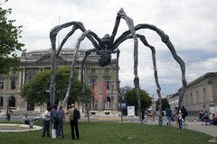 Maman in Geneva. Maman (1999) is a sculpture by the artist Louise Bourgeois. The sculpture, which resembles a spider, is over 30ft high and over 33ft wide, with Royalty Free Stock Images
