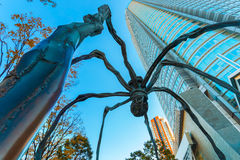 Maman - a spider sculpture at Mori tower building in Tokyo. TOKYO, JAPAN - NOVEMBER 28 2015: Maman - a spider sculpture by Louise Bourgeois, situated at the base Royalty Free Stock Image