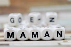 Maman, Würfelbuchstaben Lizenzfreies Stockfoto